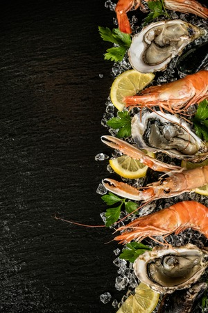 drifting ice: Seafood served on black stone, placed on ice drift