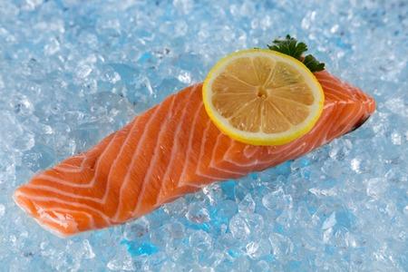 filets: Fresh salmon filets placed on ice drift Stock Photo