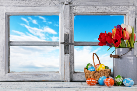 wooden window: Easter still life decoration with rustic window and hand-painted eggs. Copyspace for text Stock Photo