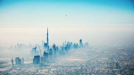 city view: Dubai city in sunrise aerial view with foggy haze