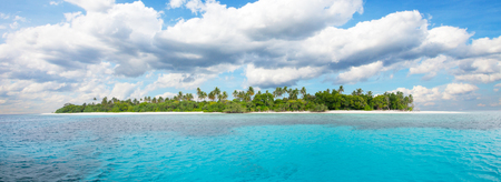 Beautiful nonsettled tropical island with perfect sky and azure water with corals Stock Photo