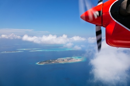 Detail of sea plane engine, flying above Maldives islands, Raa atol
