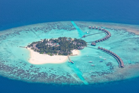 Aerial view on beautiful Maldives island in Raa atol