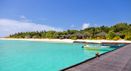 hotel resort: Tropical island resort on Maldives with wooden jetty Stock Photo
