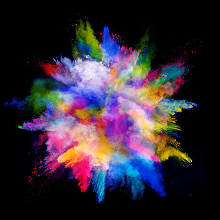 blooming. purple: Explosion of colored powder, isolated on black background Stock Photo