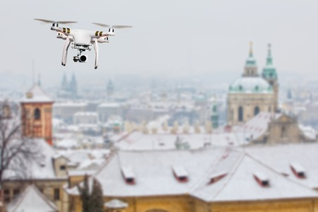 Drone flying above Prague city panorama in winter