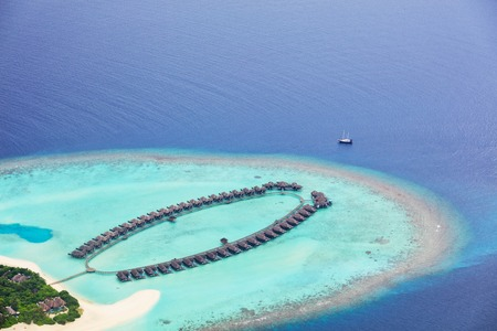 aerial: Aerial view on beautiful Maldives island in Raa atol