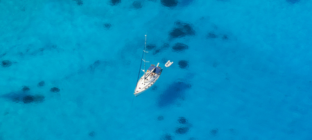 Aerial view of single yacht in azure sea, vacation and travel concept Stock Photo