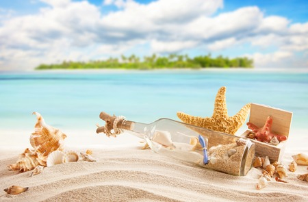 beaches: Sandy tropical beach with palm island, shells, bottle with message and starfish