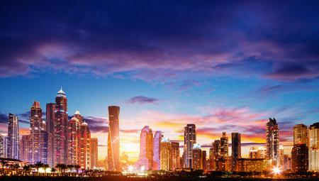 Modern buildings in Dubai Marina, Dubai, UAE at dramatic sunset
