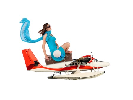 hydroplane: Young woman sitting on seaplane, isolated on white background. Concept of traveling Stock Photo