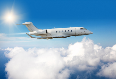 jet plane: Luxury private jet plane flying above clouds in day light