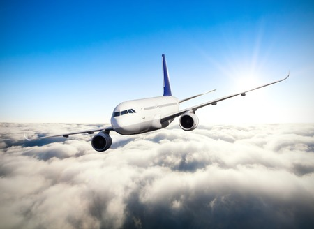 jet plane: Commercial jet plane flying above clouds in day light