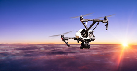 above clouds: Drone for industrial works flying above clouds in sunset. Concept of pottential danger of aircraft collision