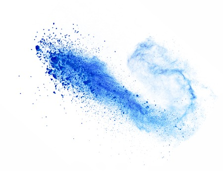 Explosion of blue powder, isolated on white background Foto de archivo