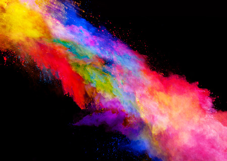 Explosion of colored powder, isolated on black background Banco de Imagens