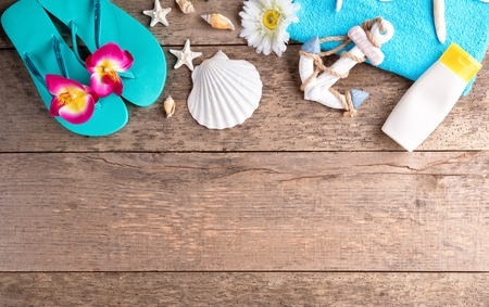 Beach accessories on wooden background, copyspace for text