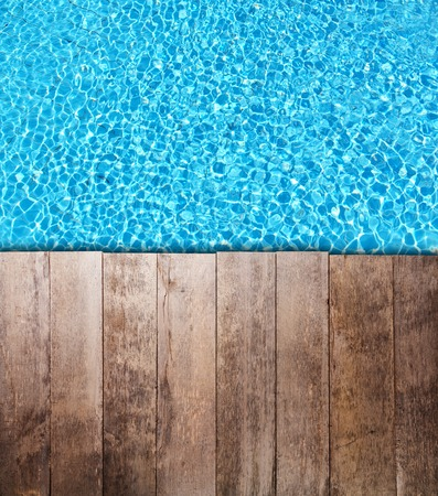view on sea: Old wooden planks placedover swimming pool surface. Ideal for copyspace of text or product placement. Stock Photo