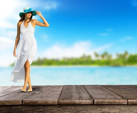 white hat: Empty wooden planks with girl walking on pier. Ideal for product placement