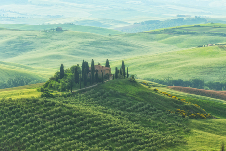 rise: Famous Tuscany Belvedere farm house in sun rise, Italy Stock Photo