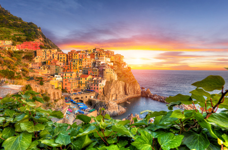 view on sea: Old village Manarola, Cinque Terre coast, Italy. Beautiful sunset view in high dynamic range.