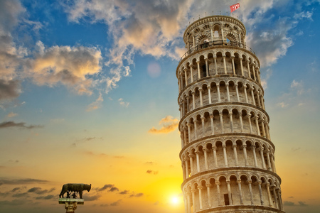 Leaning tower and the cathedral baptistery, Tuscany, Italy. Cultural heritage of UNESCO Reklamní fotografie - 56531685
