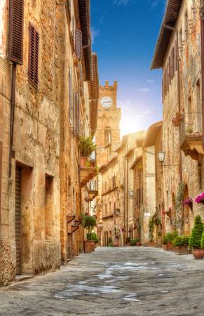 italy street: Colorful street in Pienza with many decoration flowers and trees, Tuscany, Italy