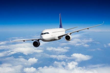 jetliner: Commercial jet plane flying above clouds in day light
