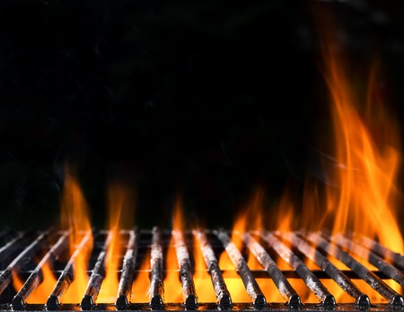 Empty grill grid in fire with black background