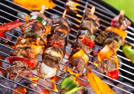 meat skewers: Grill with meat skewers shot from above view