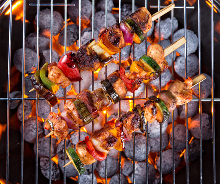 shishkabab: Grill with meat skewers shot from above view