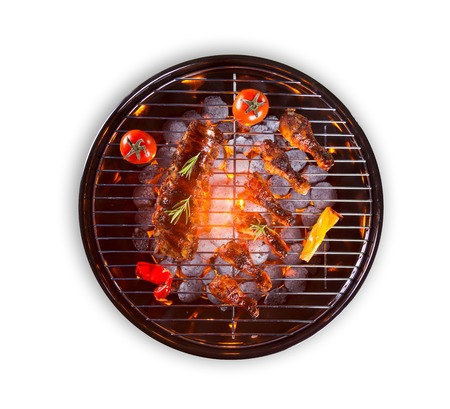 meat grill: Various kind of meat and vegetable served on grill, isolated on white background Stock Photo
