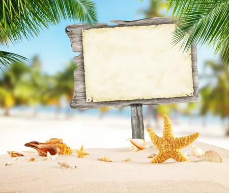 paper board: Summer concept with empty wooden board and blank paper for message. Tropical sandy beach on background.