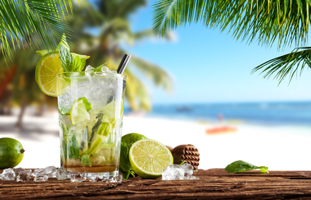 Summer cocktail with blur beach on background Stock Photo