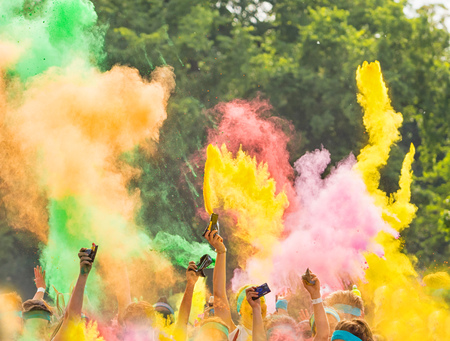 colored powder: Crowd of people on color run throwing colored powder Stock Photo