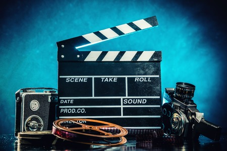 video reel: Retro film production accessories still life. Concept of filmmaking. Smoke effect on background