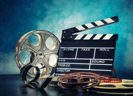 film roll: Retro film production accessories still life. Concept of filmmaking. Smoke effect on background