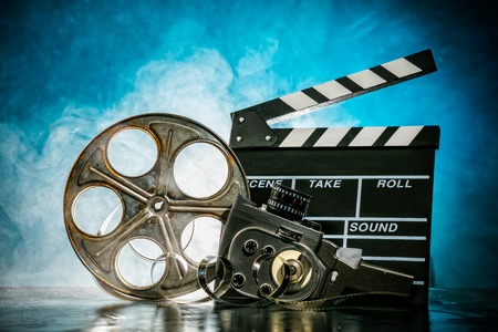 celluloid film: Retro film production accessories still life. Concept of filmmaking. Smoke effect on background