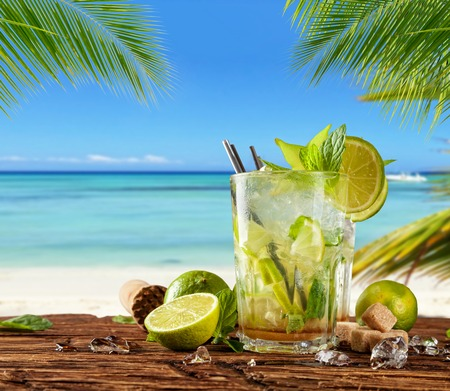 seaside: Summer mojito drink with blur beach on background. Copyspace for text Stock Photo