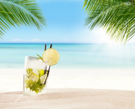 Summer mojito drink with blur beach on background. Copyspace for text Stock Photo