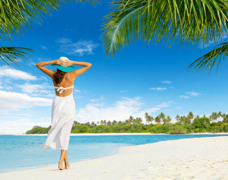 beach wear: Beautiful girl walk on tropical beach. Shot from behind. Concept of happiness and vacation