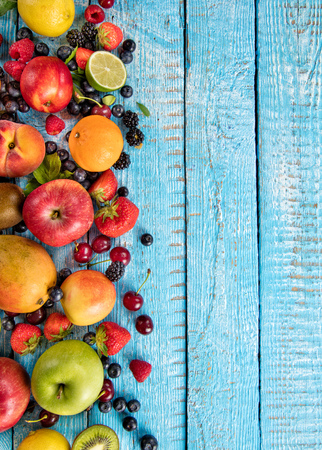 mix fruit: Close-up of fresh fruit mix placed on old wooden planks