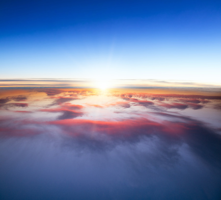 sunset clouds: Beautiful sunset above clouds from airplane perspective