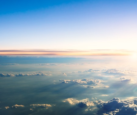 clouds and sky: Beautiful sunset above clouds from airplane perspective