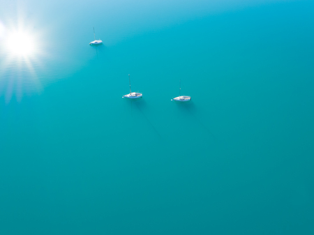 sailling: Beautiful aerial view of three yachts sailling on azure water