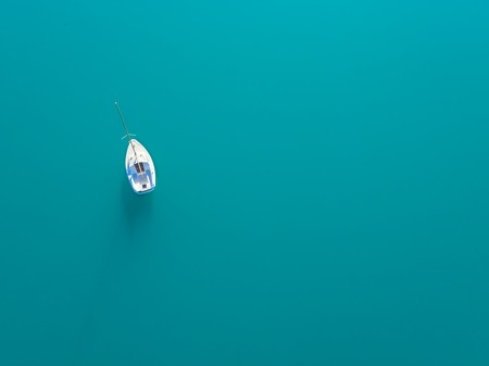 Beautiful aerial view of alone yacht sailling on azure water Stock Photo