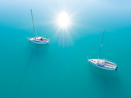 sailling: Beautiful aerial view of two yachts sailling on azure water