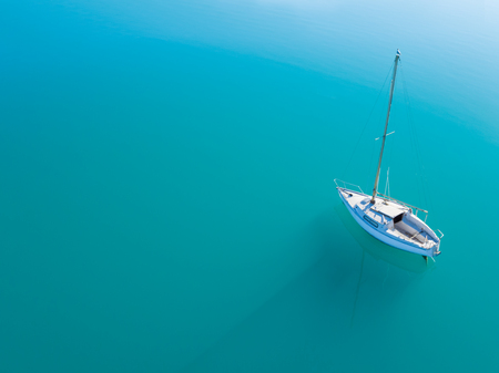 sailling: Beautiful aerial view of alone yacht sailling on azure water Stock Photo