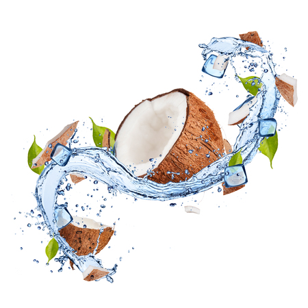 isolated on green: Pieces of coconuts in water splash and ice cubes, isolated on white background Stock Photo