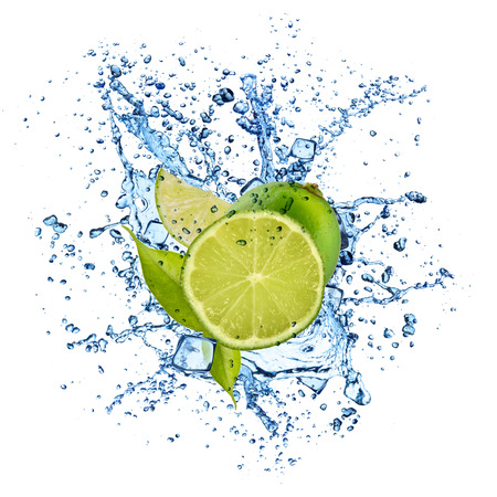 lime: Pieces of limes in water splash and ice cubes, isolated on white background